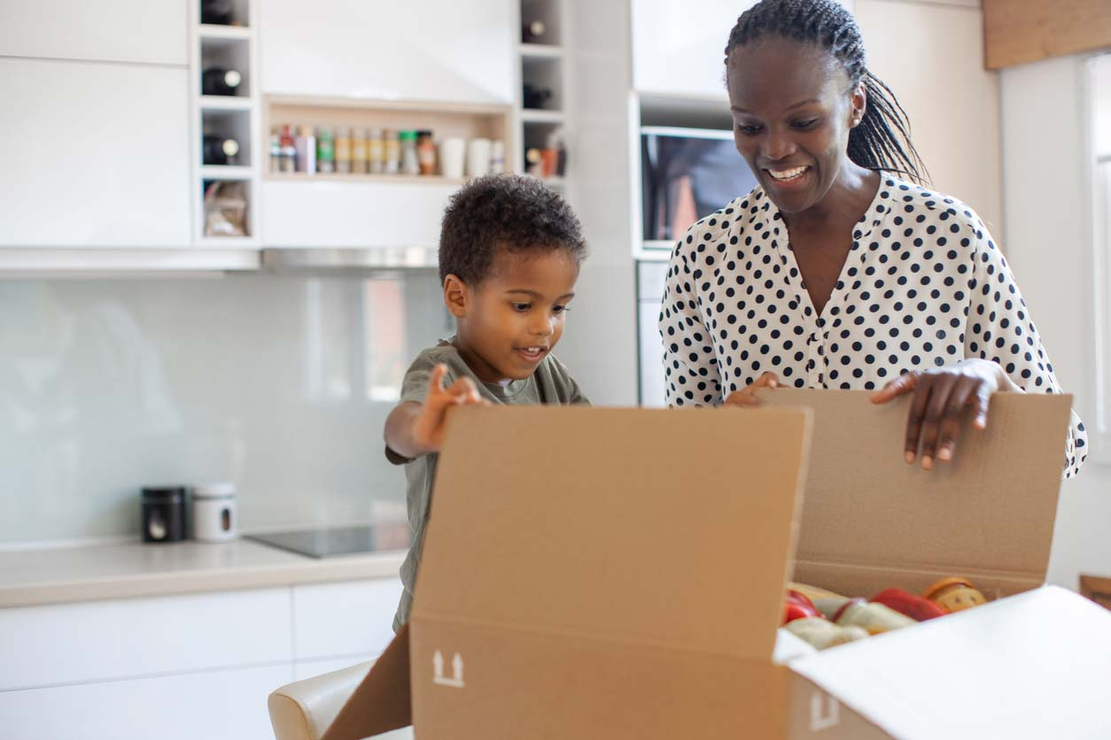 mother and child opening meal subscription box