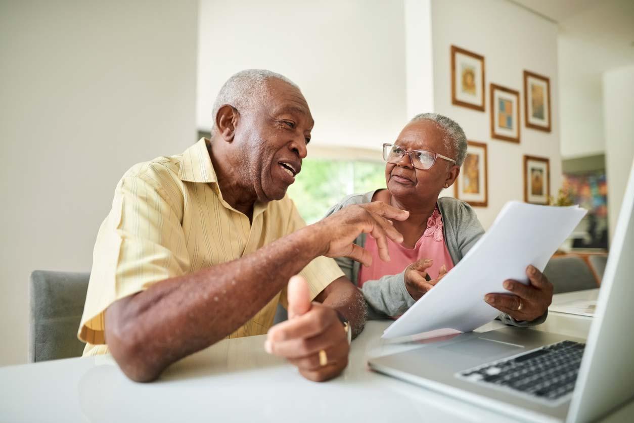 Older couple talking over paperwork