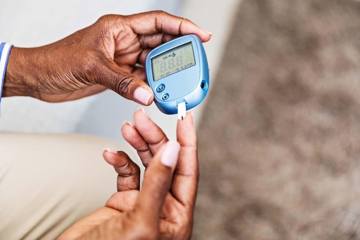 someone measuring blood sugar