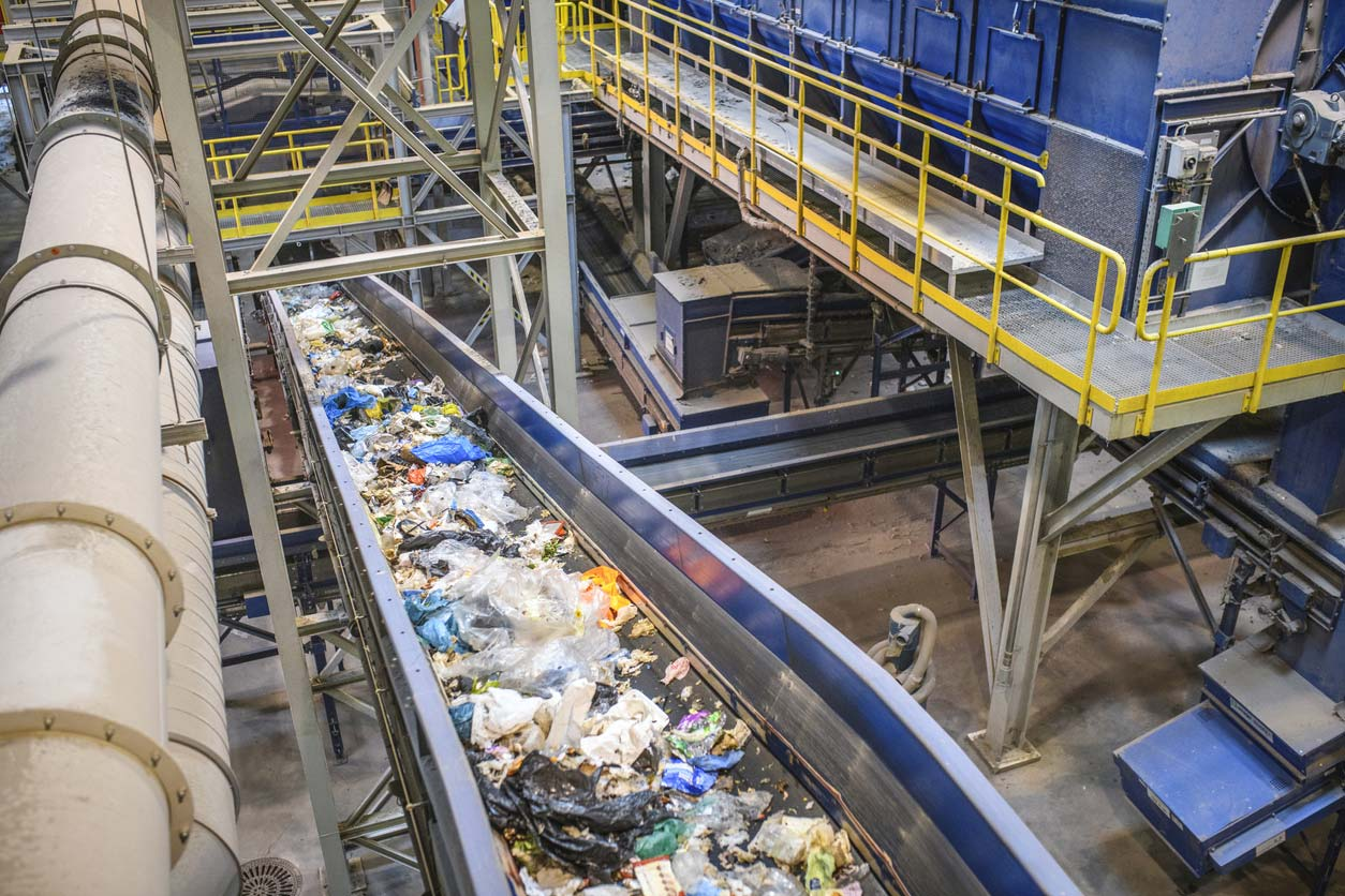 conveyor belt for recyclables in waste processing facility