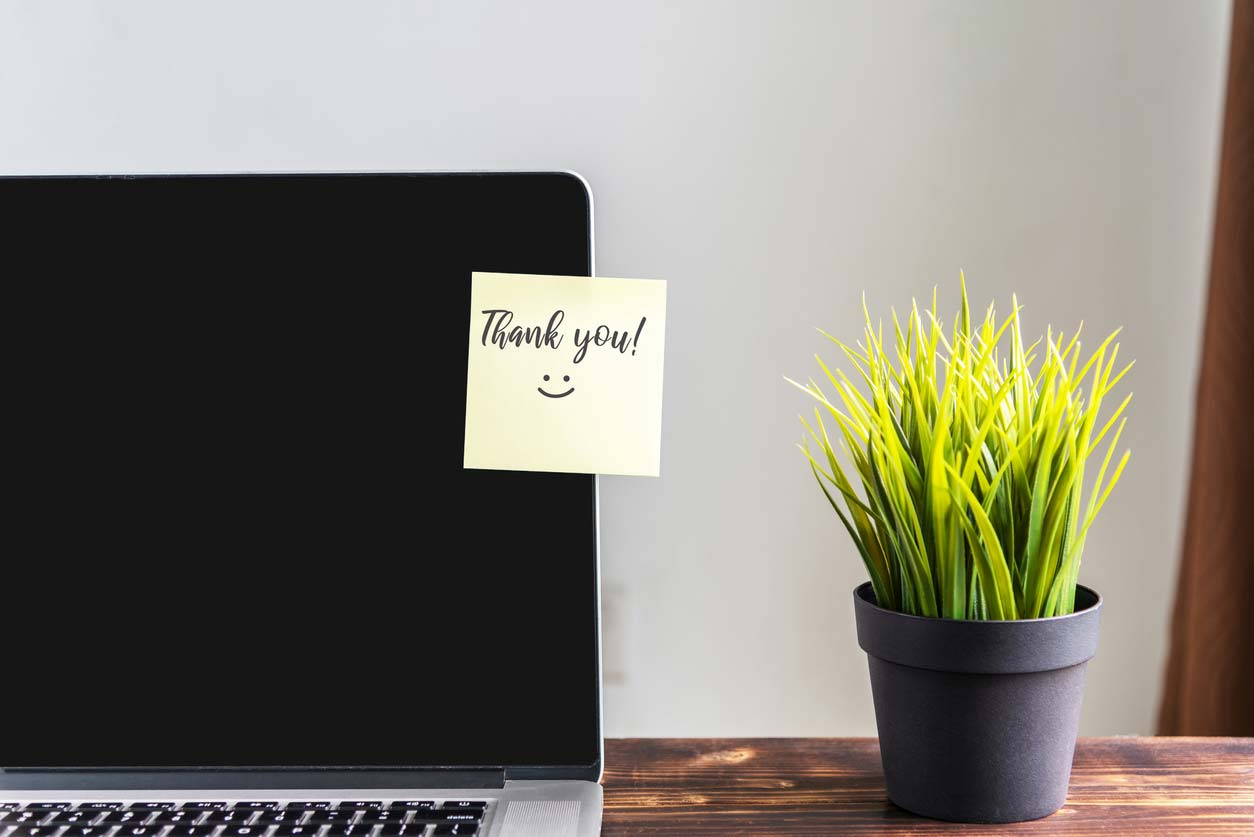 sticky note on laptop screen saying thank you