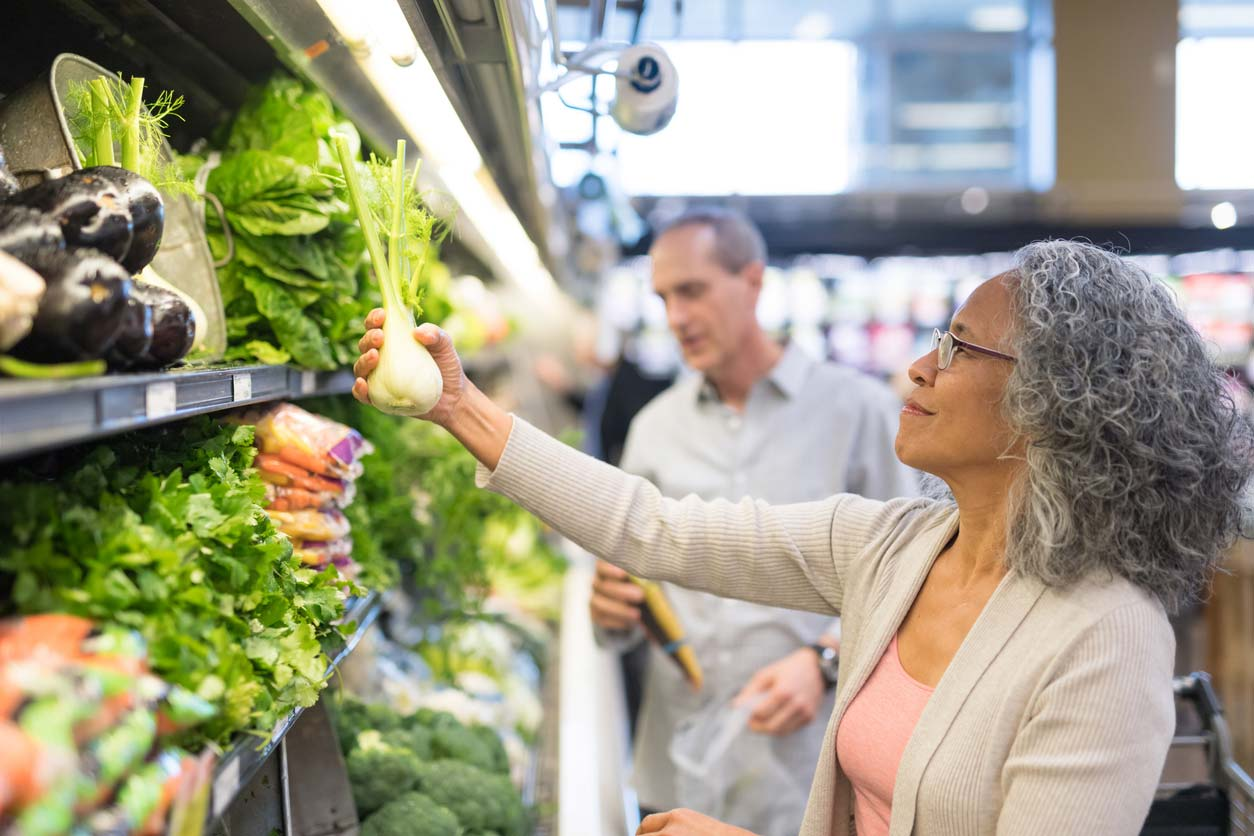 Senior couple shops at supermarket