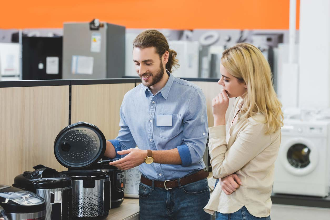 sales rep talking over slow cookers with customer