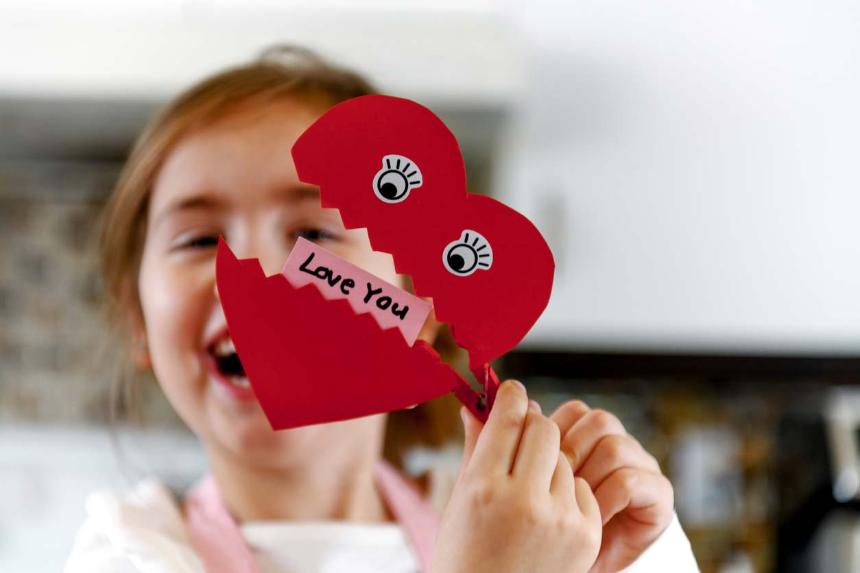young girl with heart clip that says love you