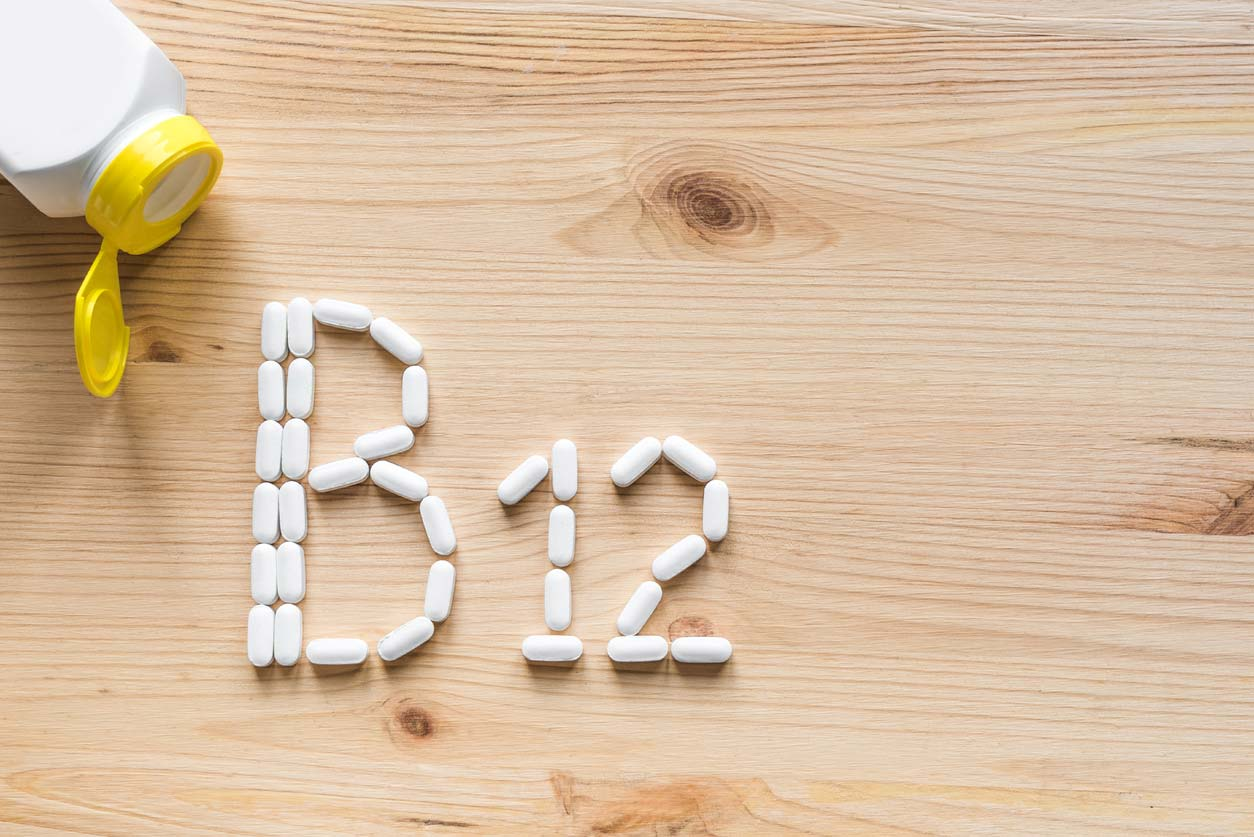 b12 written in supplement capsules on table