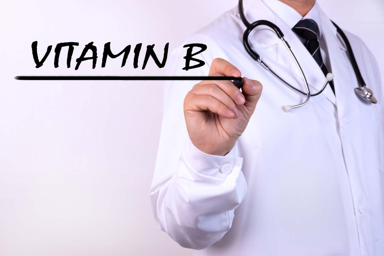 doctor writing vitamin b words with marker