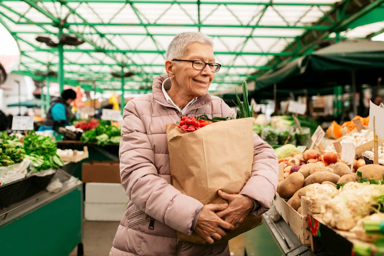 elderly person shopping at farmers market