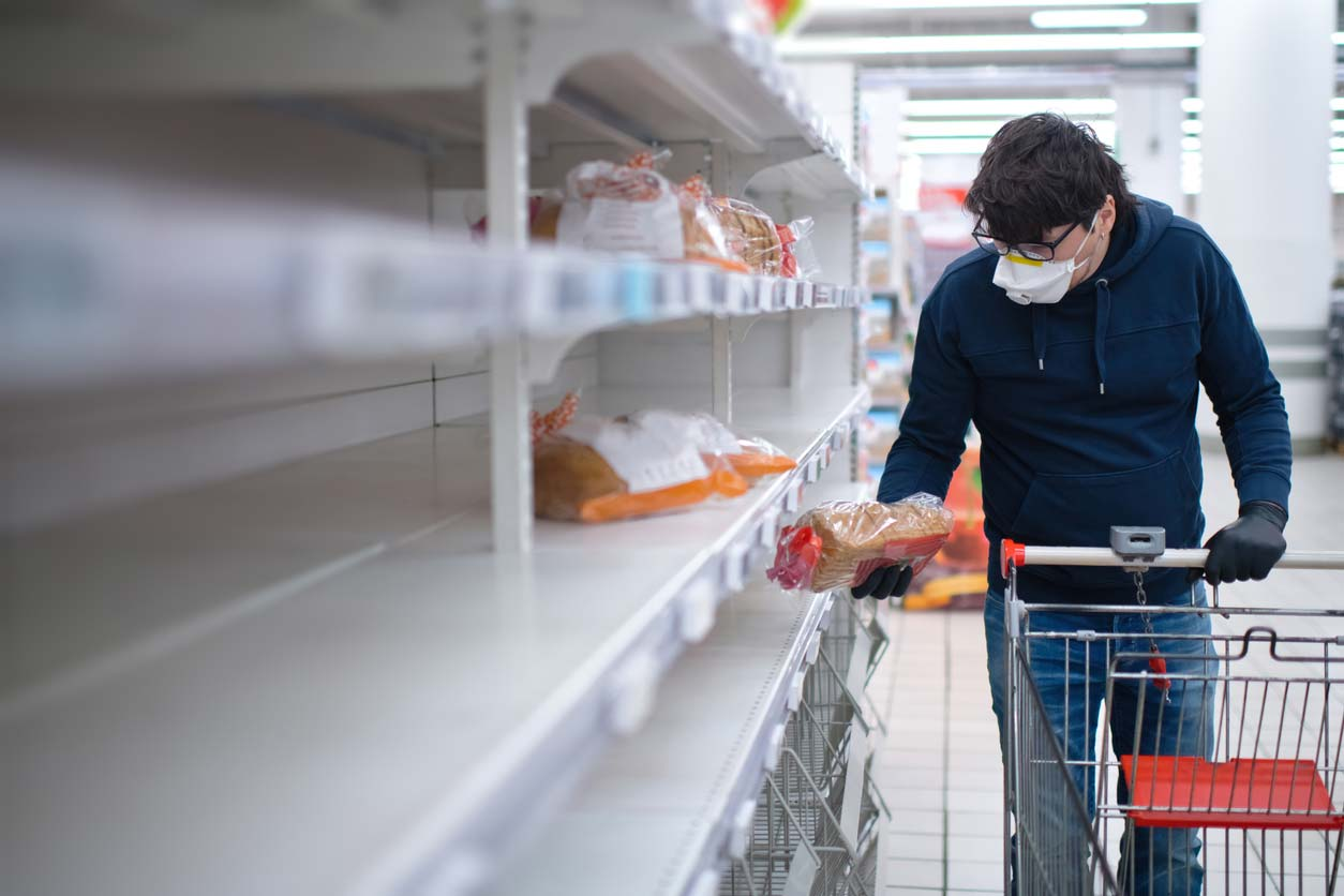 man in ppe grocery shopping