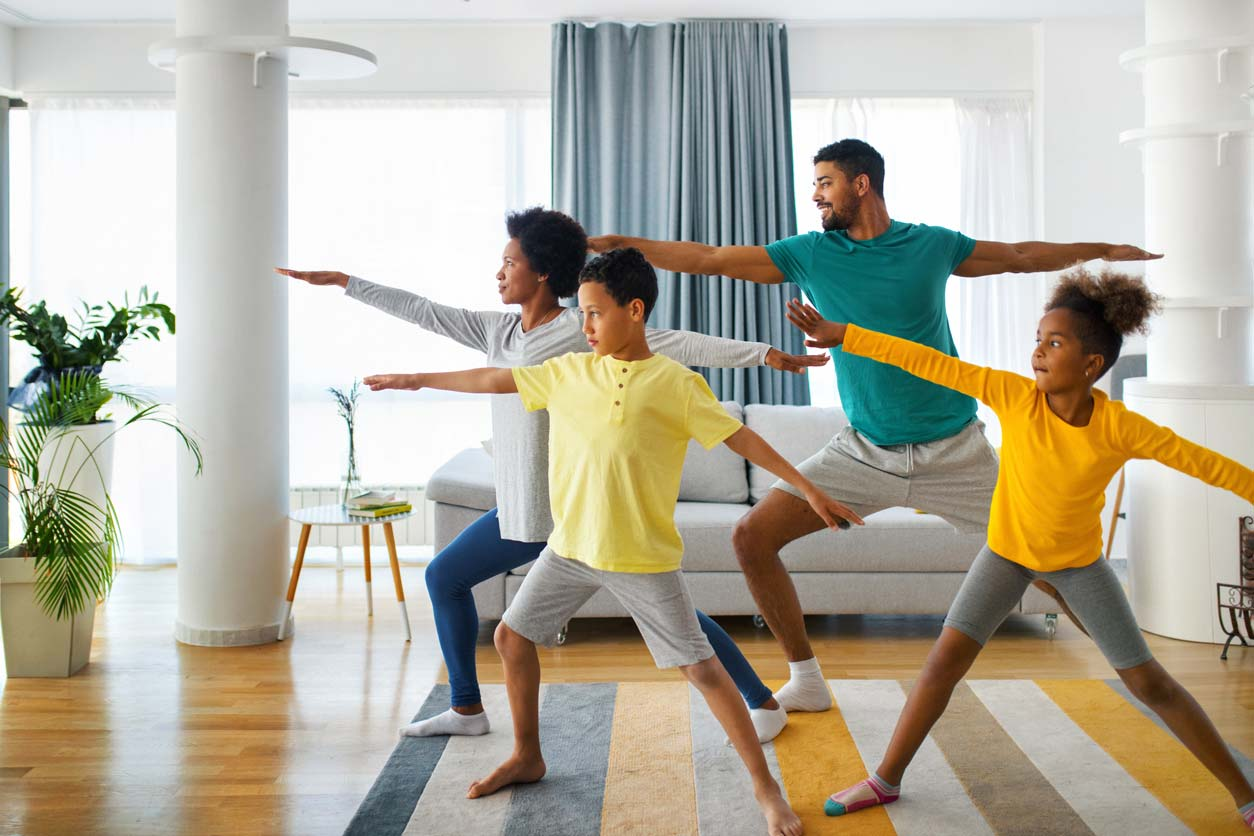 Family doing yoga to prevent osteoporosis