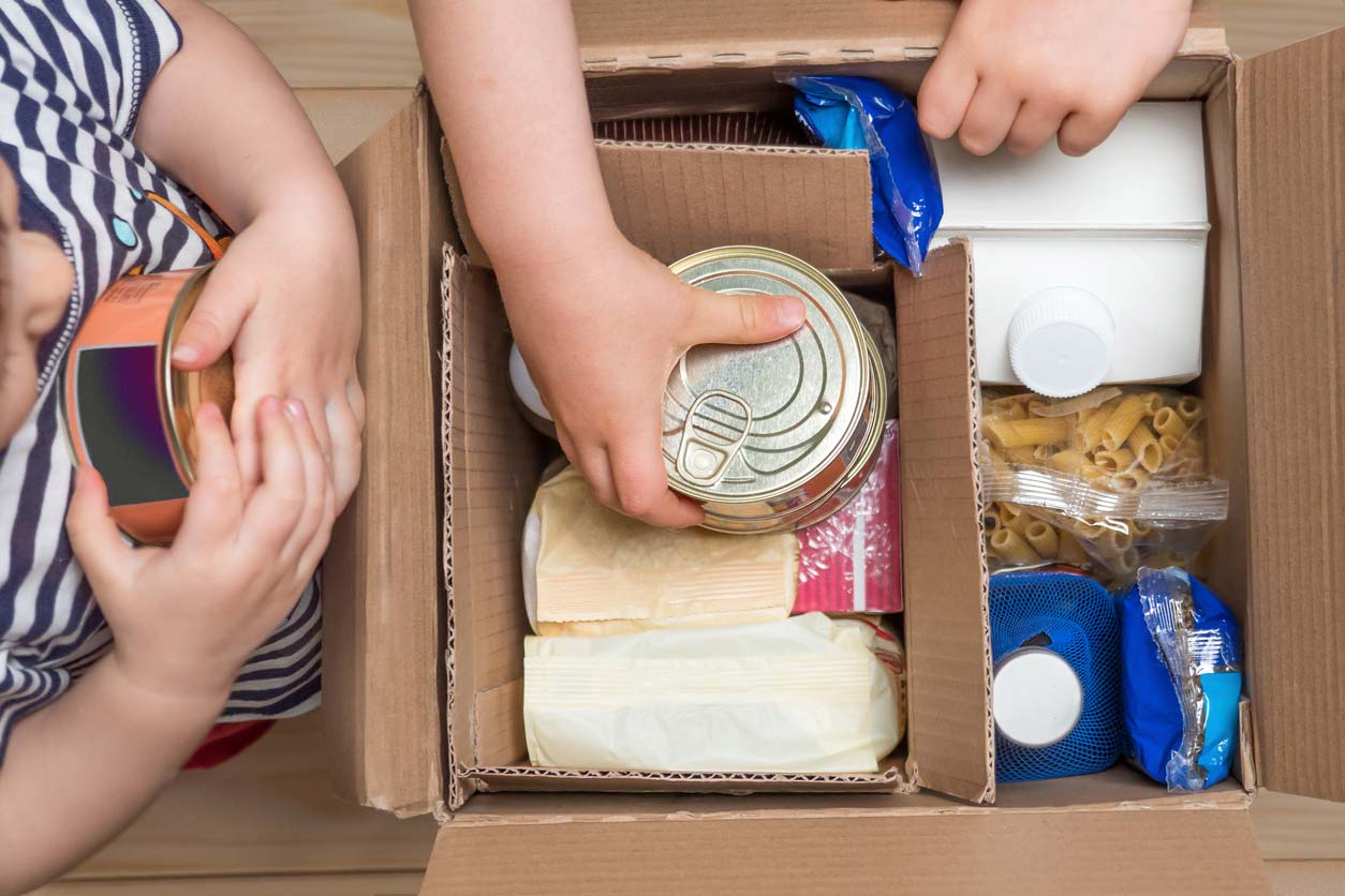 Children opening food box of food donations