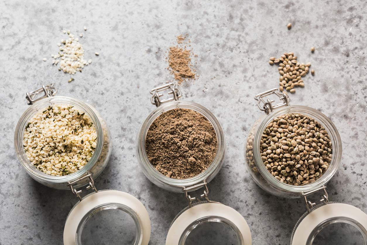 Hemp seeds, hearts, and powder in jars