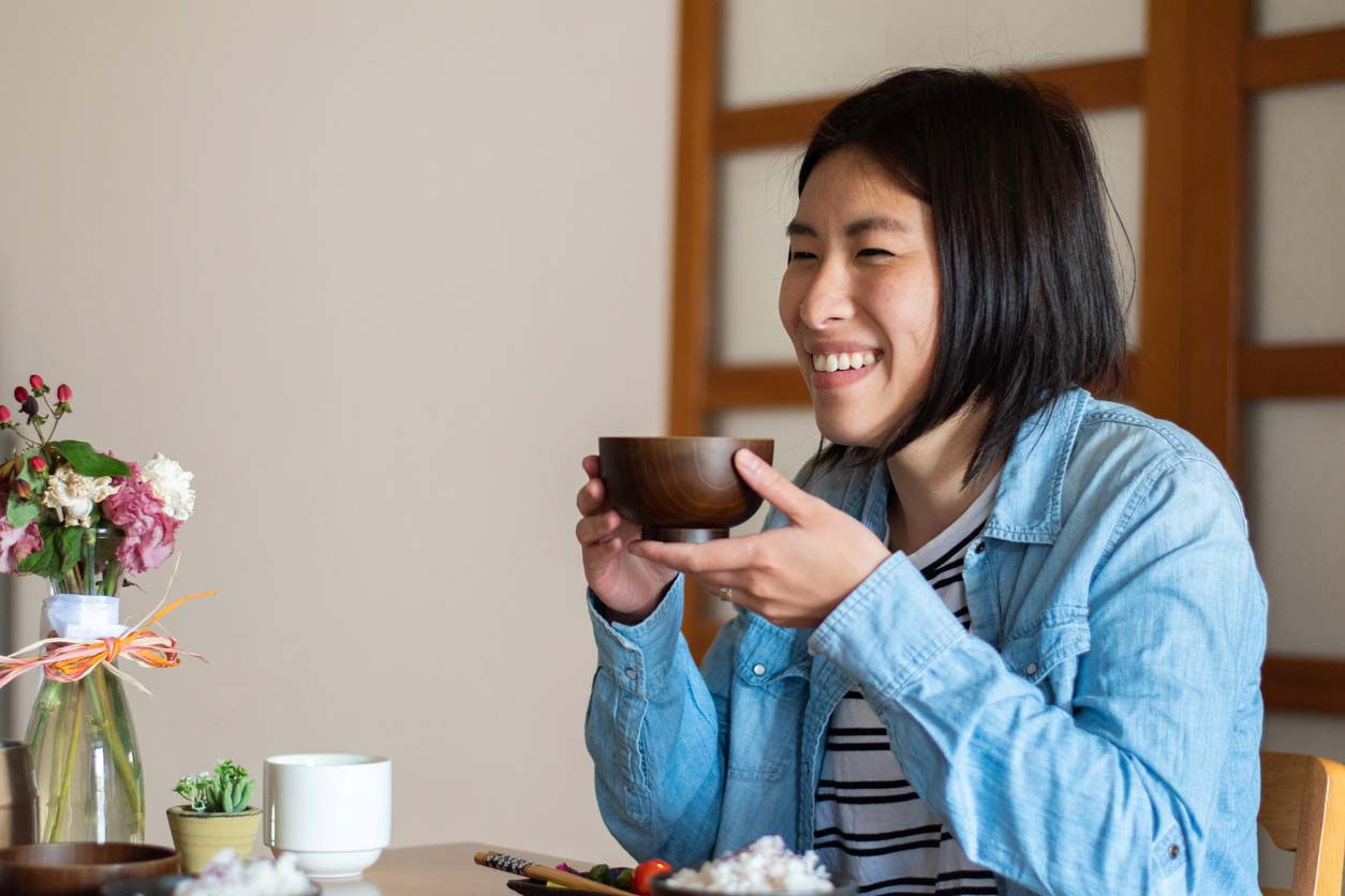 woman eating japanese style breakfast