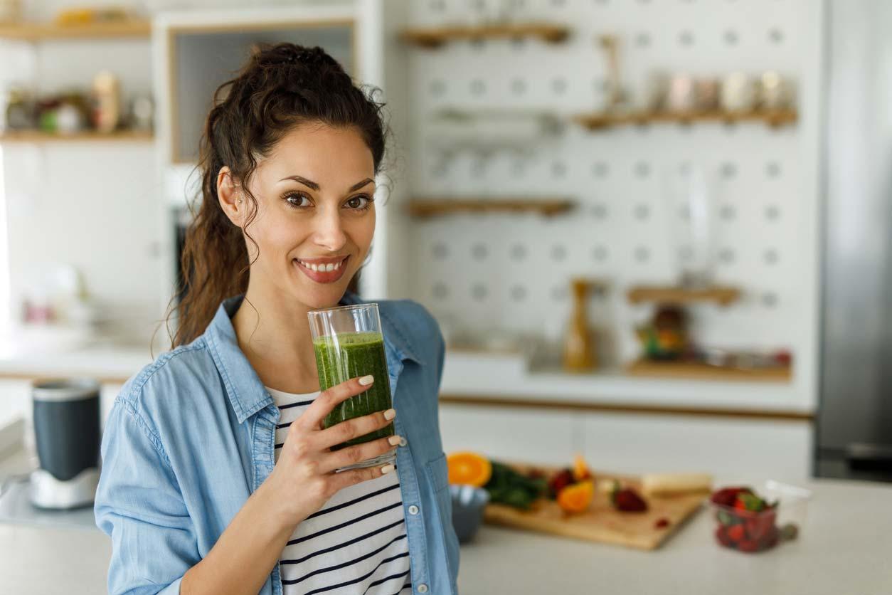 woman enjoying green smoothie