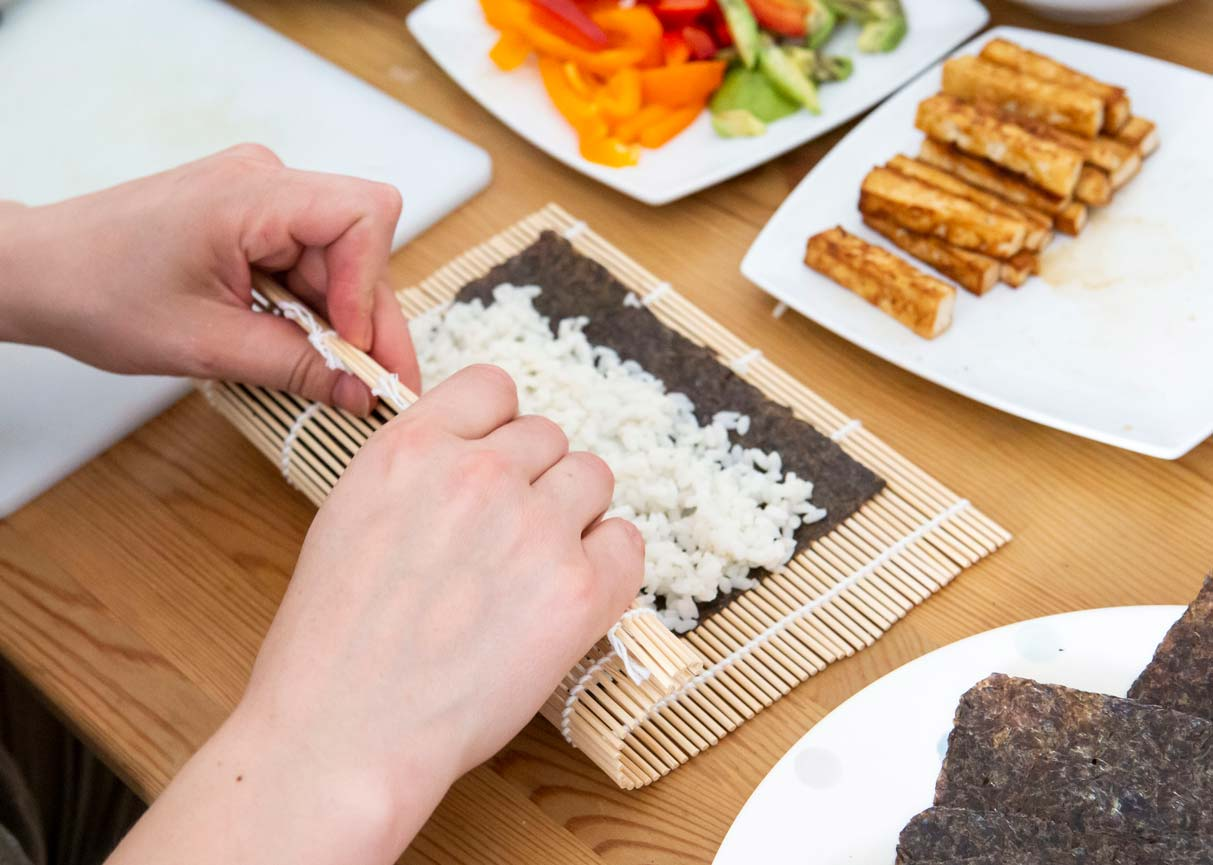 preparing to roll up vegan sushi