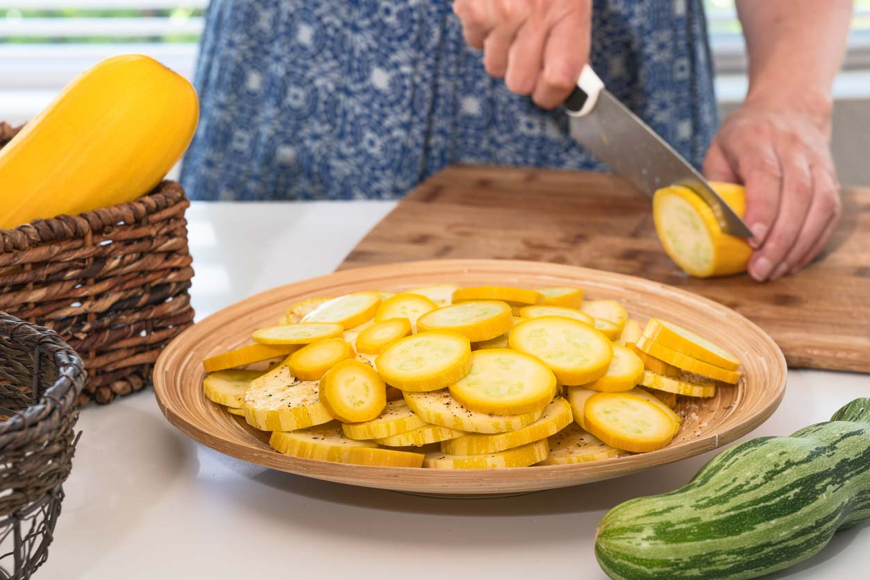 Slicing yellow squash for healthy recipe