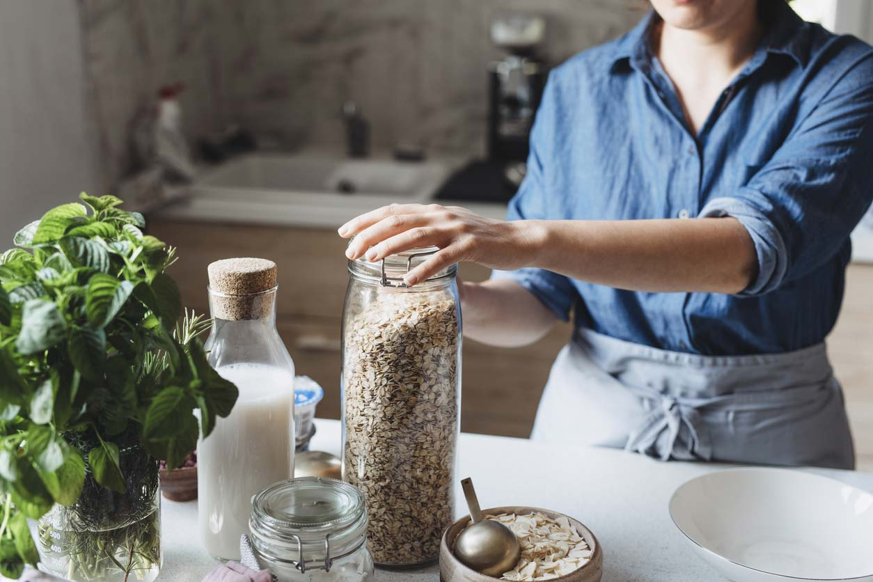 woman using rolled oats to make meal