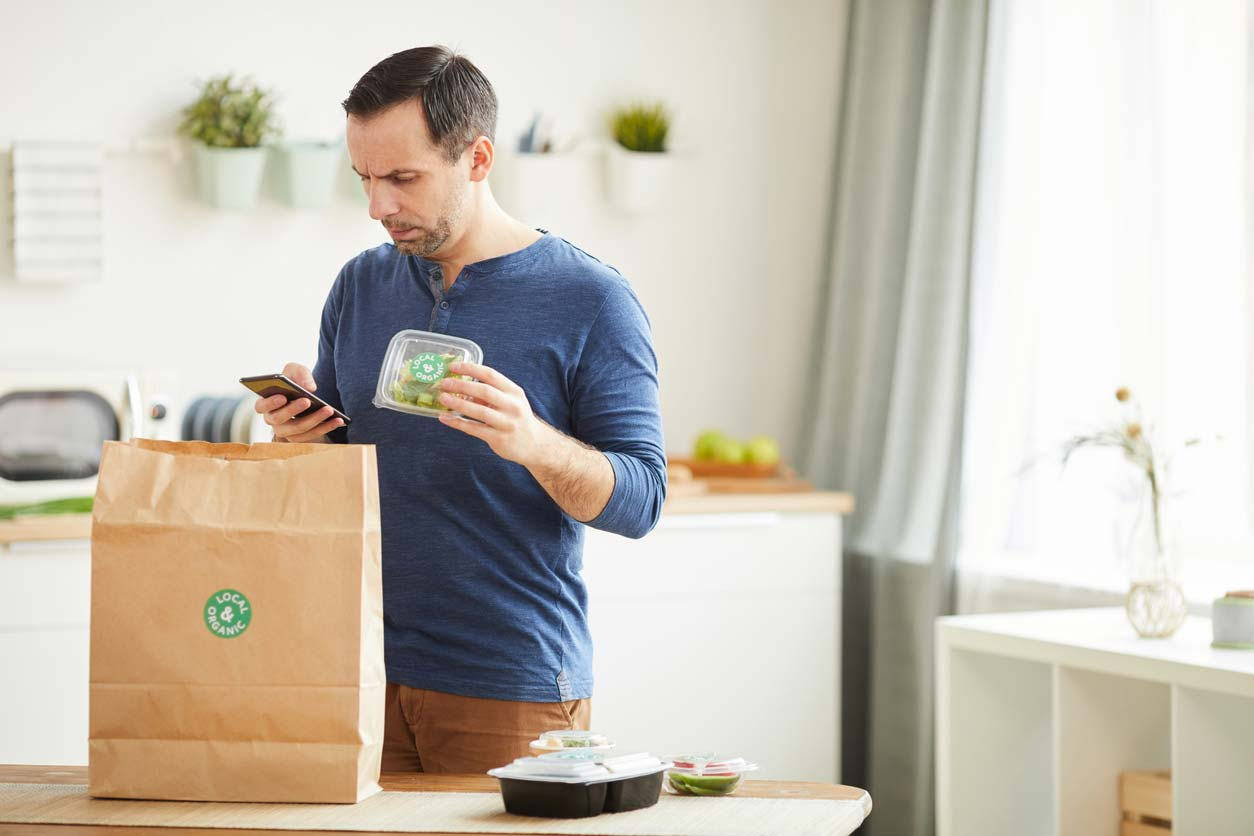 man unpacking meal delivery service bag