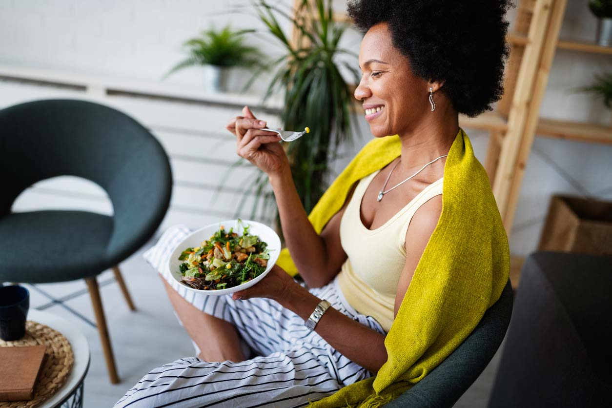 woman of color eating a healthy salad