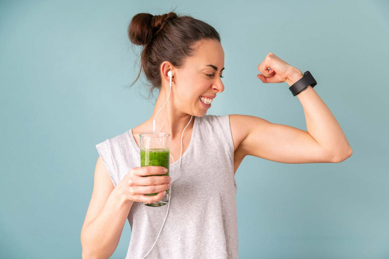 woman drinking post workout spinach smoothie