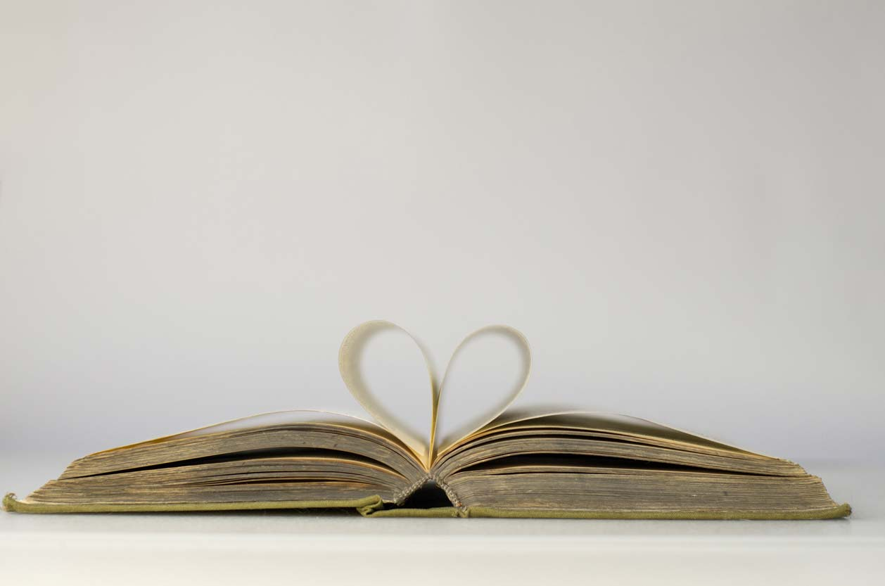 open book with pages making heart shape