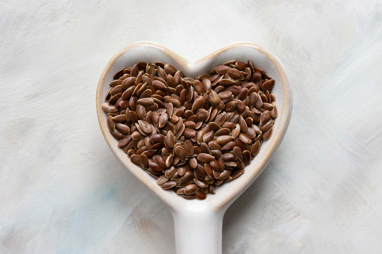 flaxseeds in a heart shaped spoon