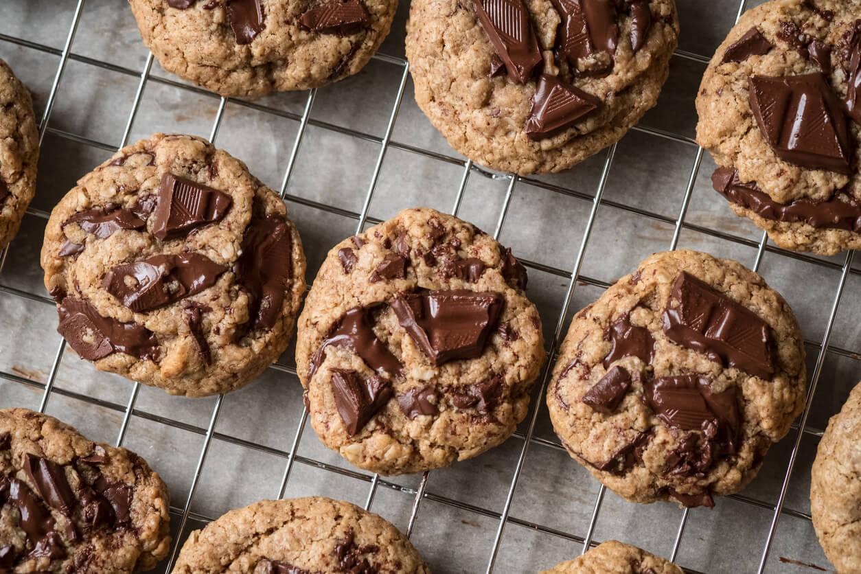 vegan homemade chocolate chunk cookie warm desserts on cooling rack flat lay
