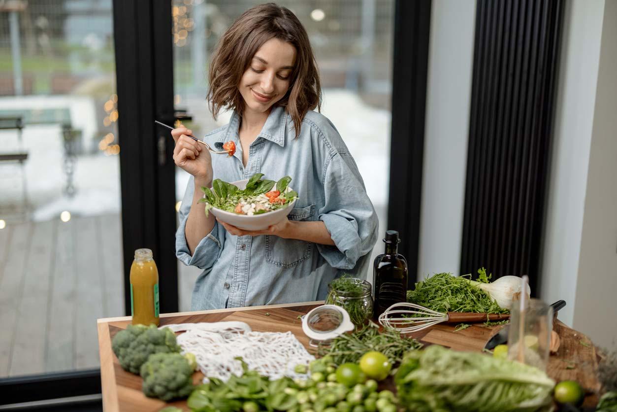 woman admiring her healthy salad recipe