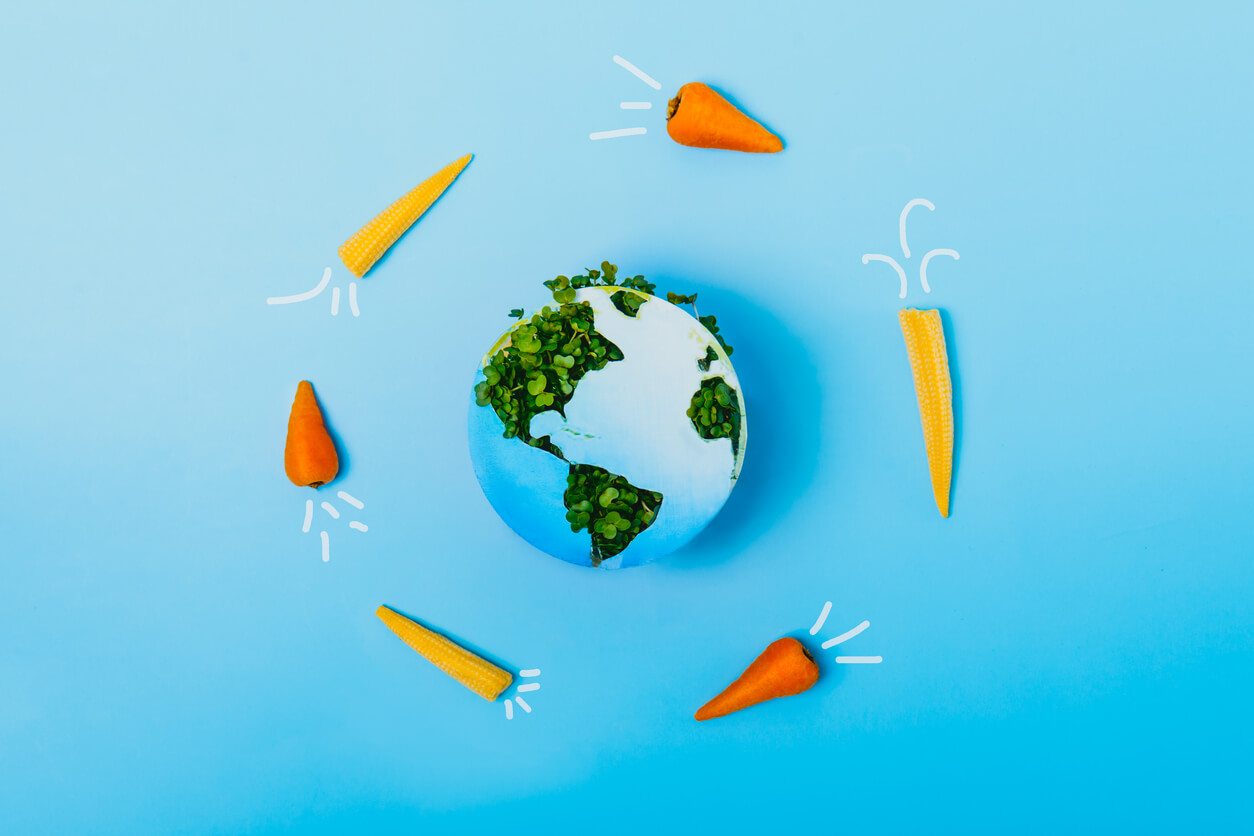 creative veganism and earth day concept rockets of carrots and baby corn flying