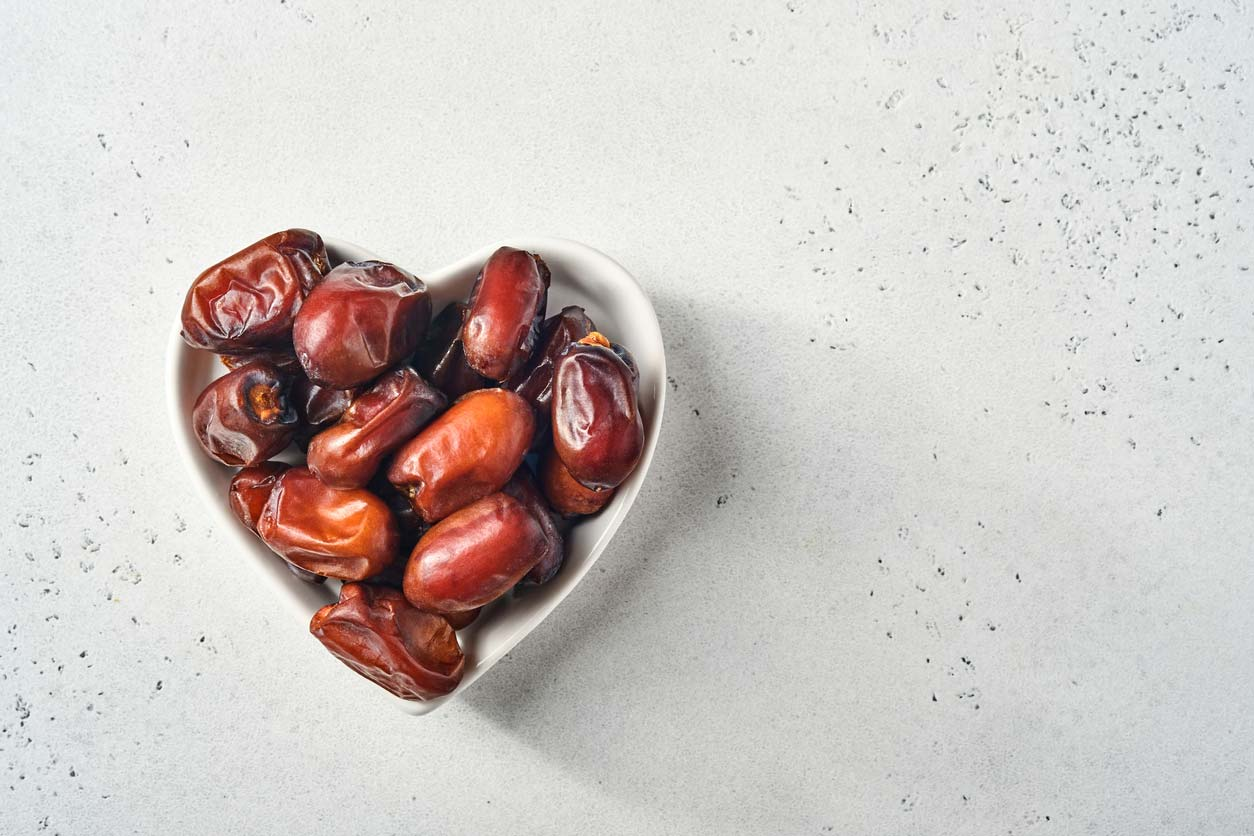 dates in heart shaped bowl