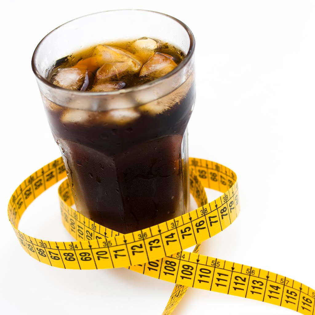 soda with measuring tape around it