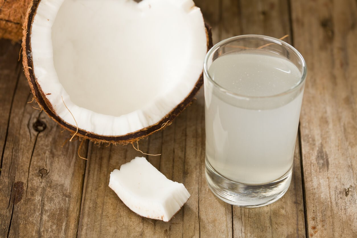 Coconut Water and coconut on table
