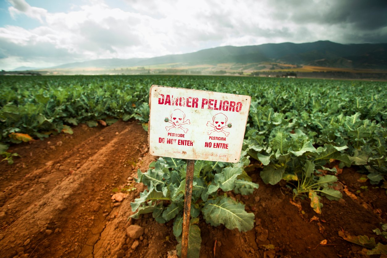 Poison pest control chemicals sprayed on a field in the Salinas Valley, California USA