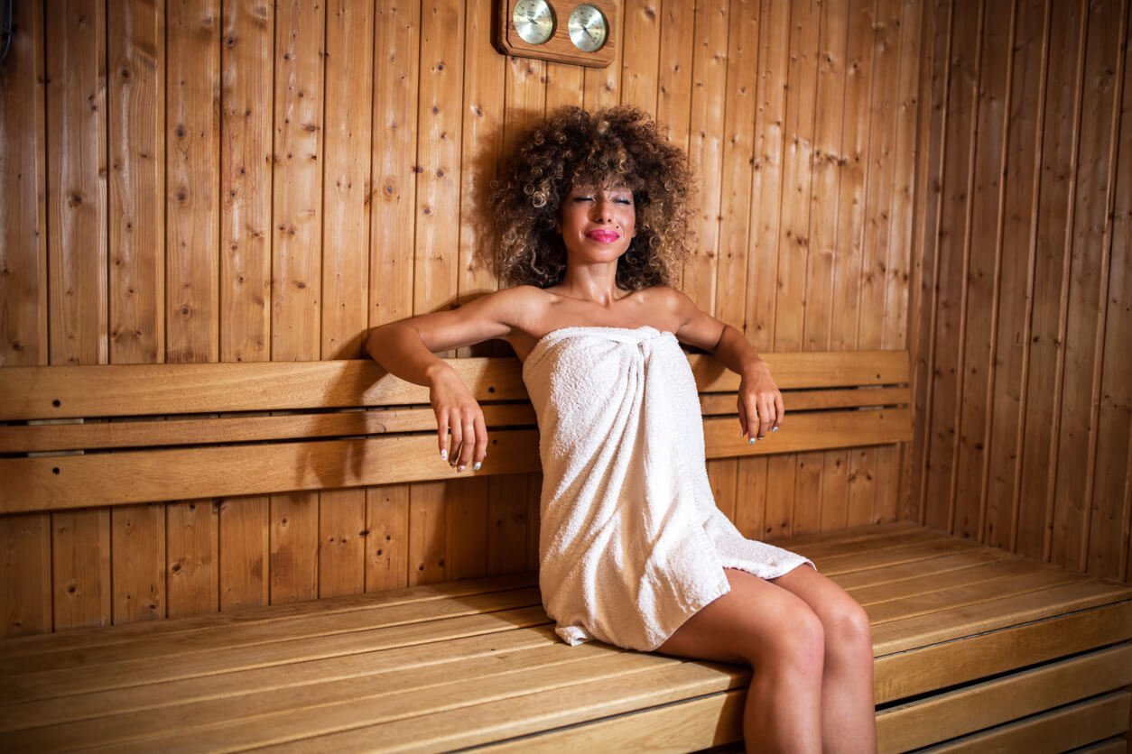 Woman enjoying the sauna benefits