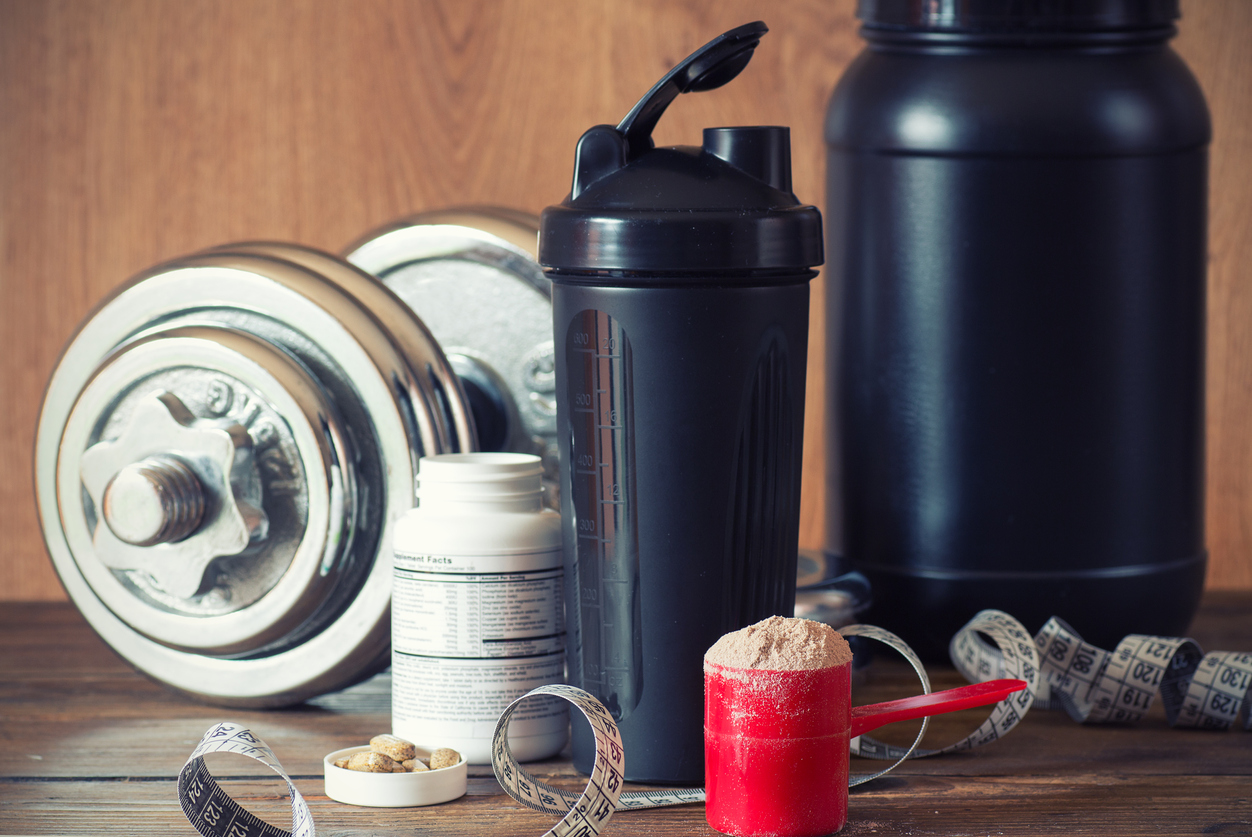 A variety of sports related supplement containers and athletic tools
