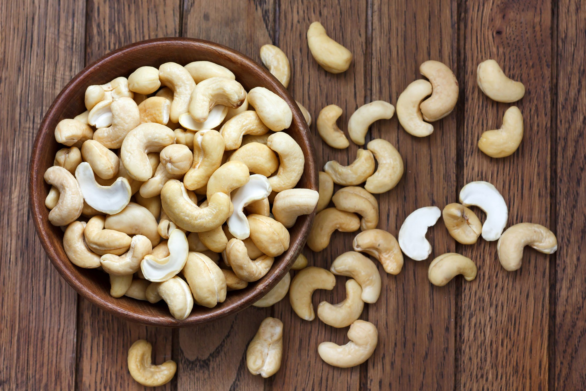 cashews in a bowl and on the table