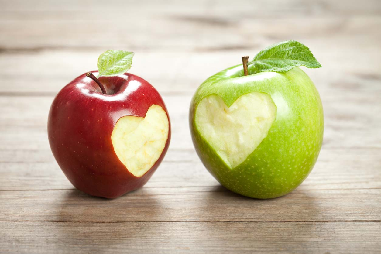 two apples with heart bites