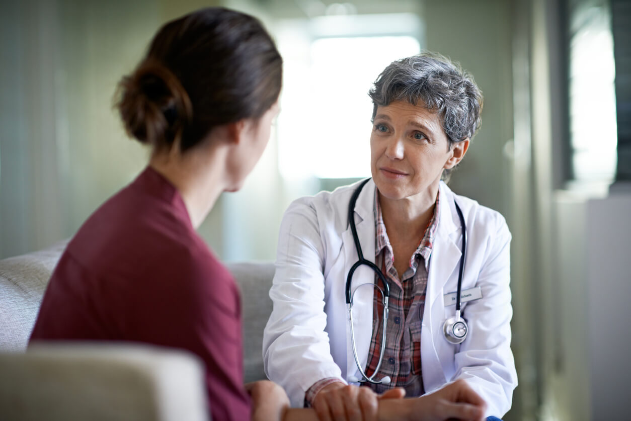 doctor discussing lifestyle disease prevention with her patient