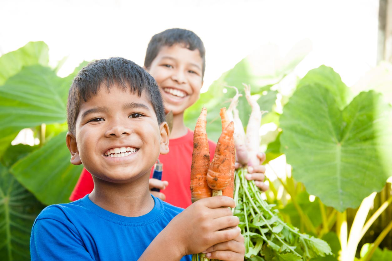 children excited about carrot harvest