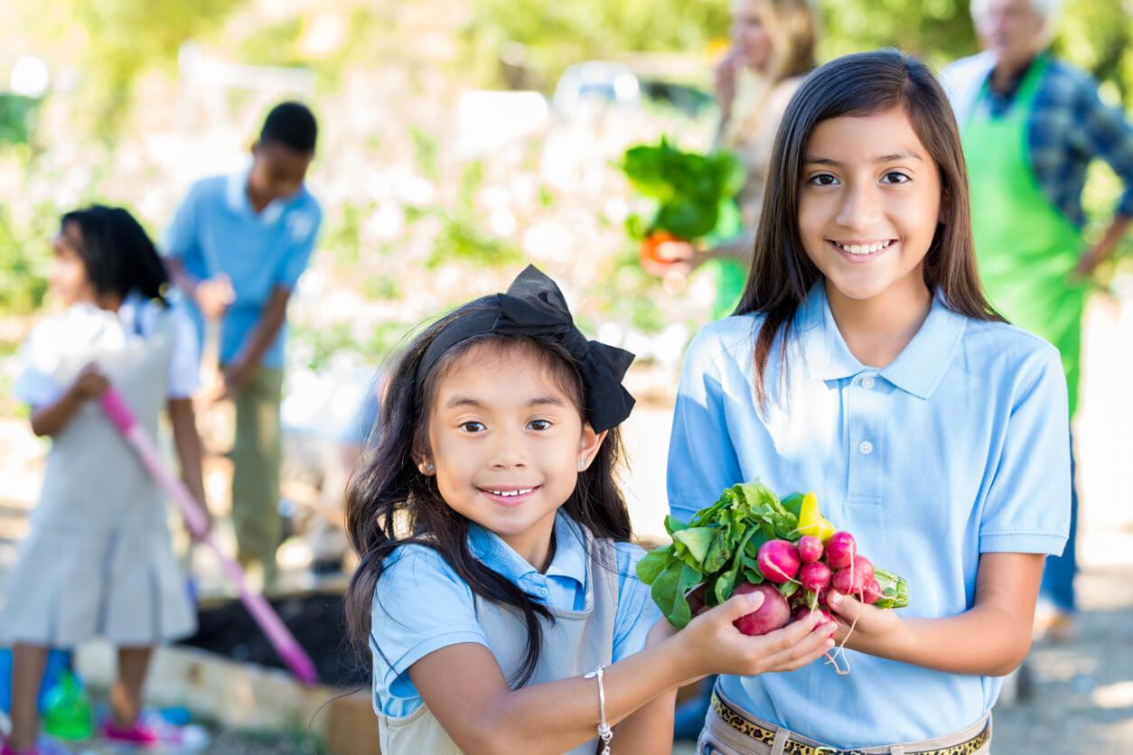 elementary girls touring garden during farm field trip