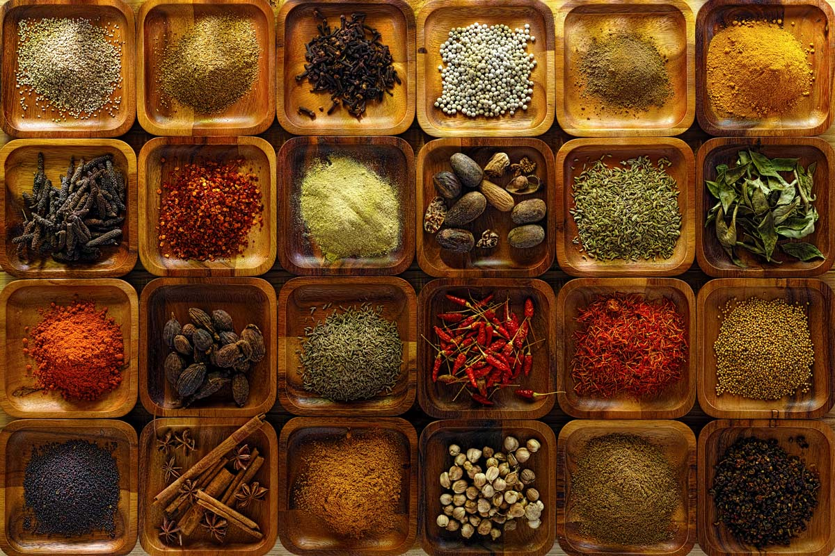 indian spices in wooden trays