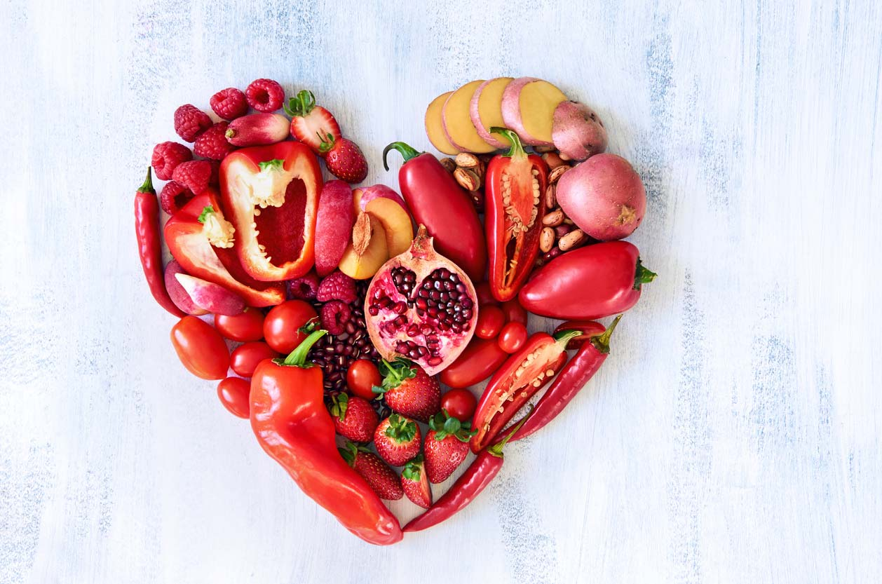 red heart made from red fruits and veggies