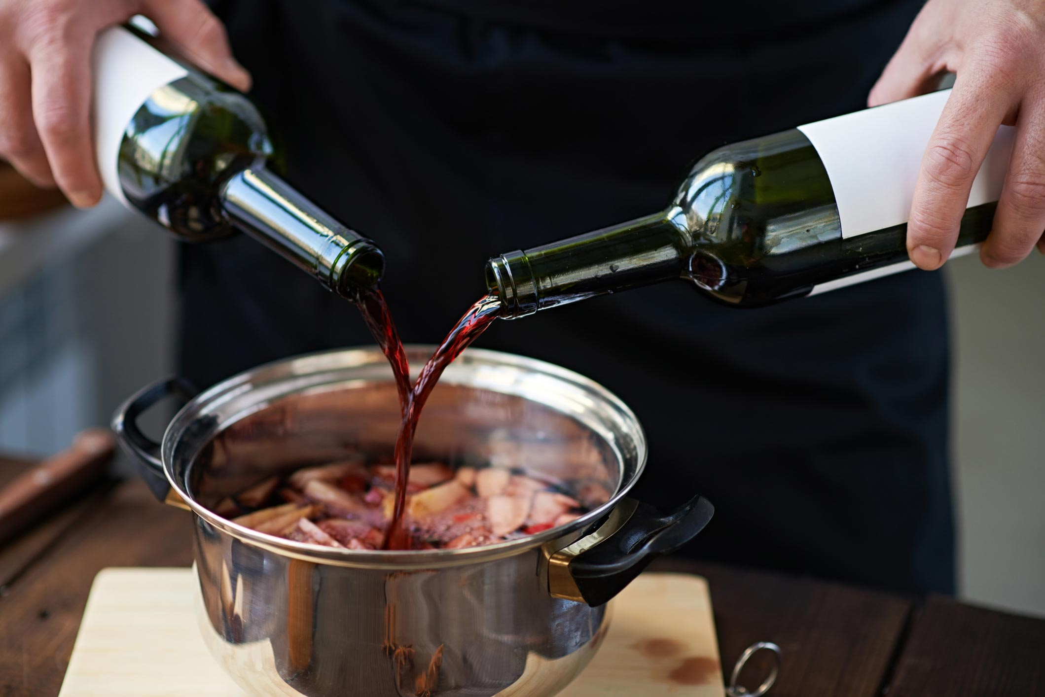 pouring wine into pot