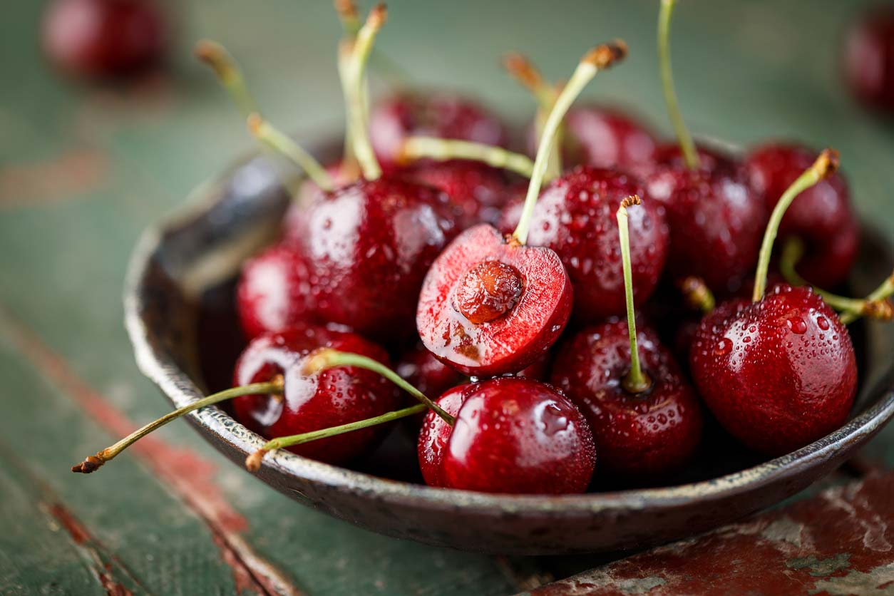 cherries in serving bowl with pit exposed
