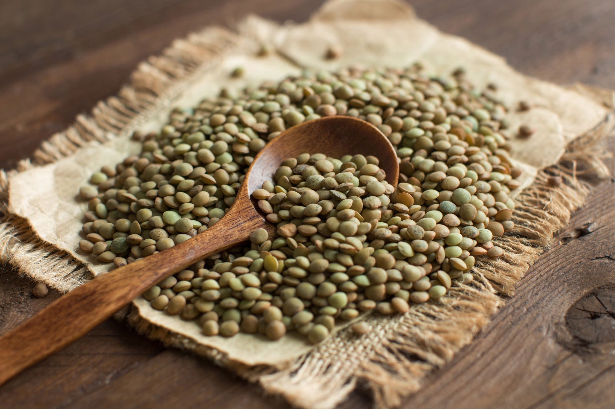 lentils with a wooden spoon