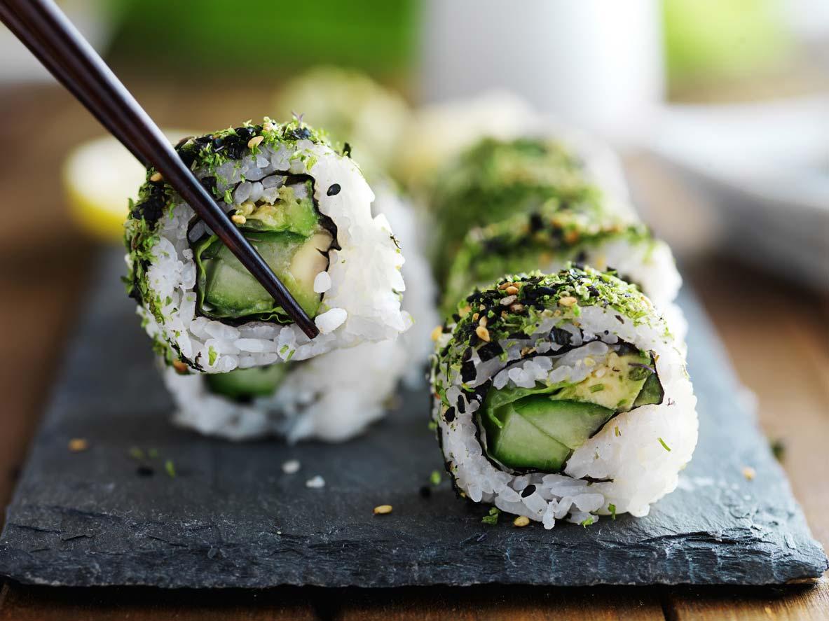 kale vegan sushi rolls on board