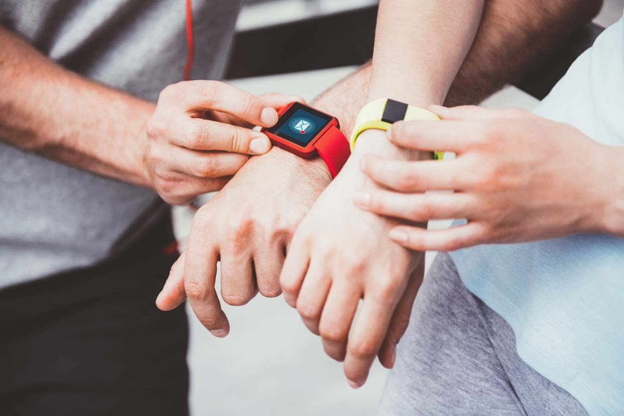two people sharing data between their two wrist-based health trackers