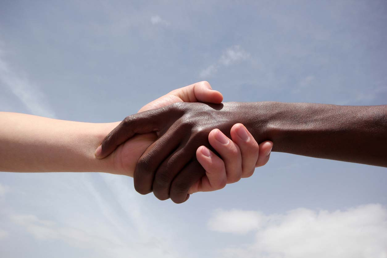 black and white human hands in handshake