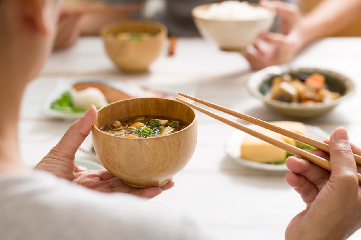 Enjoying miso in a bowl with chopsticks