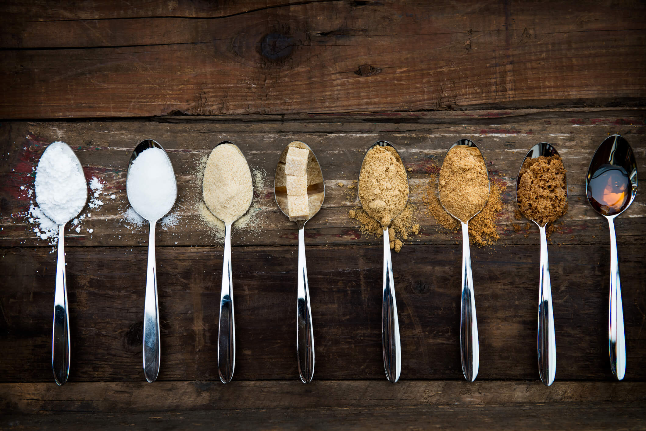 Different types of sugar in spoons