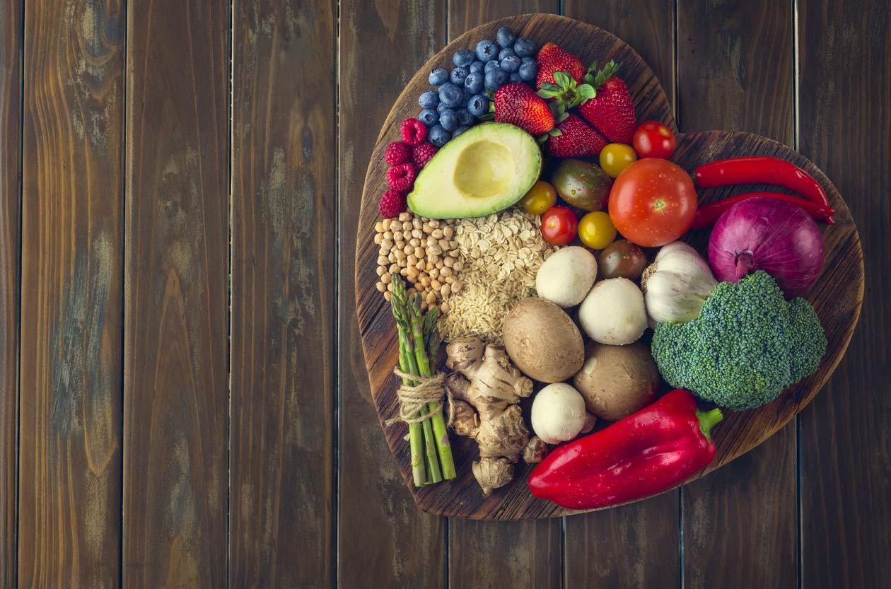 healthy food on heart shaped cutting board